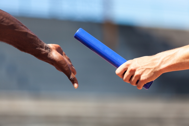 Relay baton representing SEO working with PPC in Japan to achieve success in Japanese market