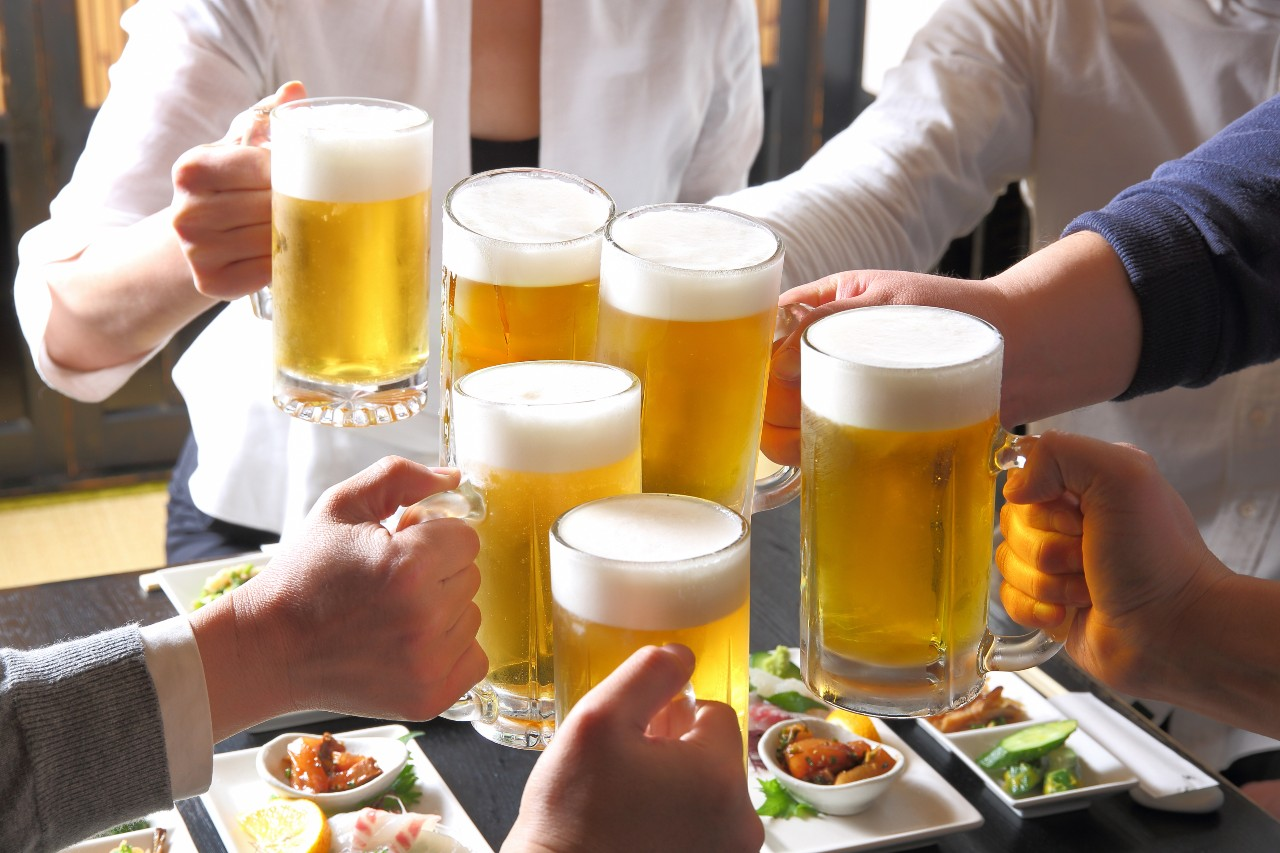 Colleagues socialising with beer as part of Japanese business culture