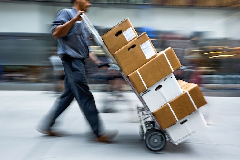 Courier delivering package for merchants who sell on Amazon Japan
