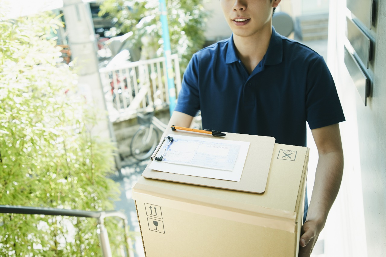 Delivery guy arriving with package from ecommerce in Japan