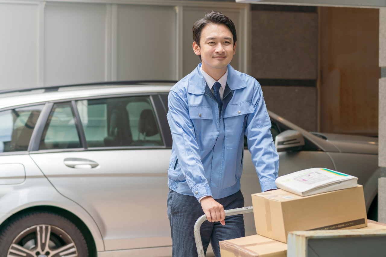 Ecommerce in Japan delivery worker moving packages after transport
