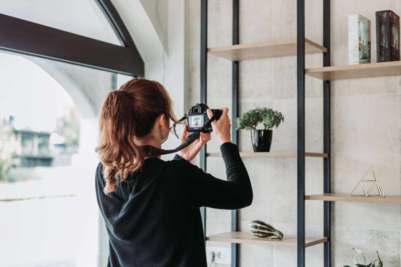 Employee taking product photos to support ecommerce logistics in Japan
