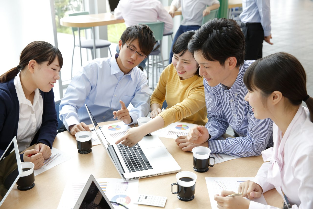 Japanese company reviewing content from translation services in Tokyo