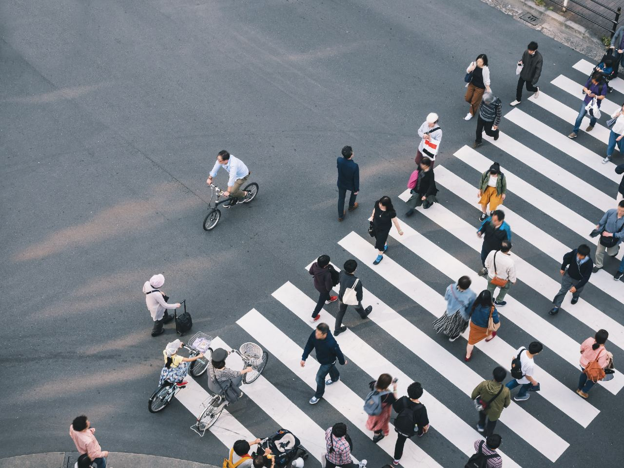 Japanese people crossing the road representing different demographics using social media