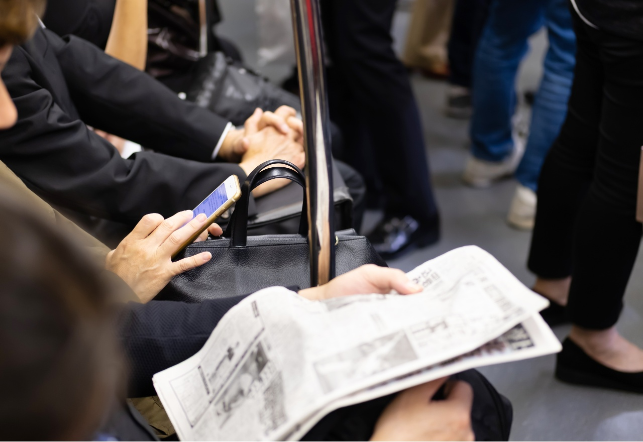 Man on train reviewing content published by PR agencies in Japan
