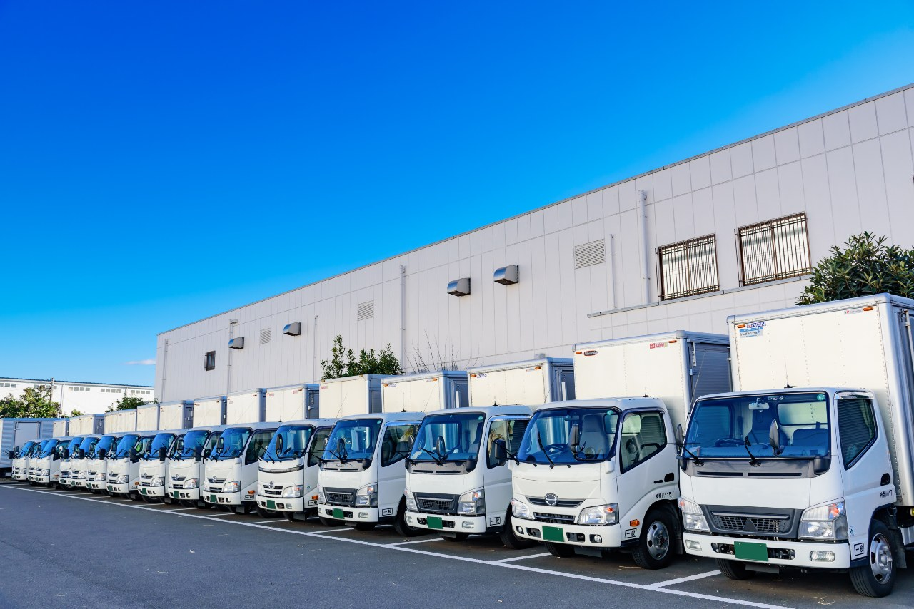 A row of delivery trucks waiting to support ecommerce logistics in Japan