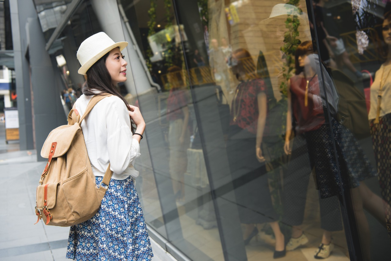Selective Japanese shopper window shopping for reliable brands