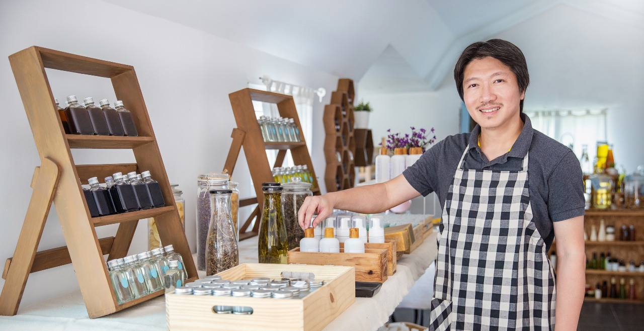 Shop owner displays products and example of effective branding in Japan