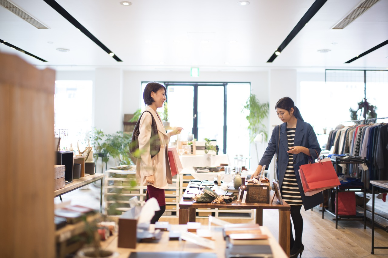Two loyal shoppers browsing shop and branding in Japan