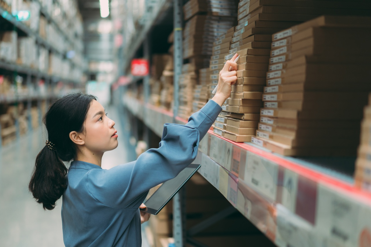 Warehouse manager handling stock for company selling online in Japan