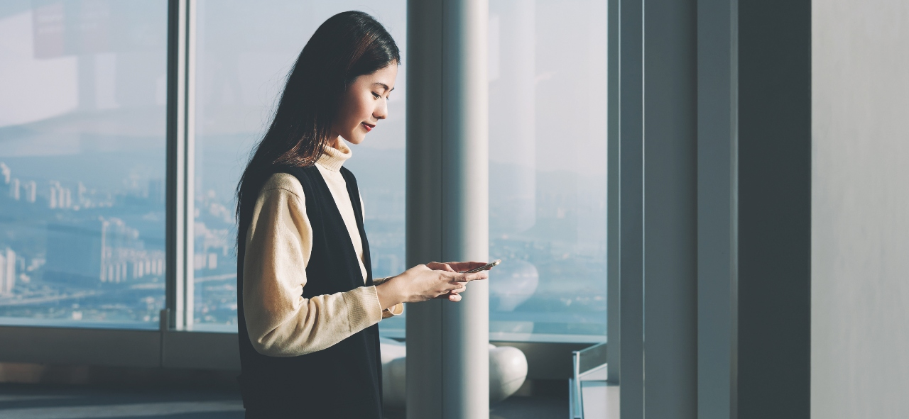 Woman using mobile searches and encountering search ads in Japan